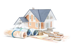 Home finances - house and money Stock Photo