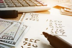 Free Home Finances. Paper With Calculations, Calculator And Money. Stock Images - 119745694
