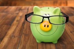 Home Finances. Pig Intelligence Glasses Tax Finance Family royalty free stock images