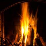 Home Fire burning in brick fireplace. Seasonal and holiday fire,. Great Home Fire burning in brick fireplace. Seasonal and holiday fire, Closeup Royalty Free Stock Image