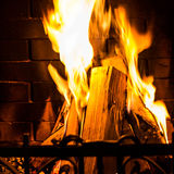 Home Fire burning in the fireplace. Seasonal and holiday fire Stock Images