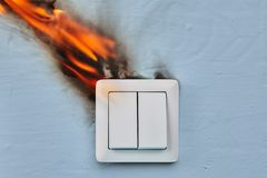 Faulty wiring blamed for House fire. Home fire caused by faulty wiring in light switch stock image