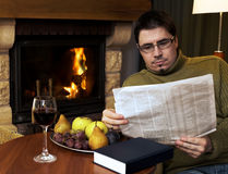 At home by the fireplace Royalty Free Stock Photography
