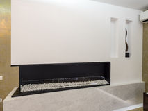 Home fireplace. Apartment fireplace, interior design and decoration Stock Image
