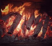 Home fireplace with beautiful orange fire close-up royalty free stock image