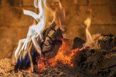 Home fireplace with beautiful orange fire and wood fire close. Burning fire in the fireplace. Logs on fire.  stock photos