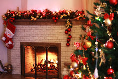Home fireplace in the Christmas decorations royalty free stock images