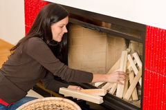 Home fireplace woman put logs happy winter Royalty Free Stock Image