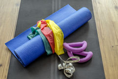 Home fitness accessories on yoga mat Stock Photo
