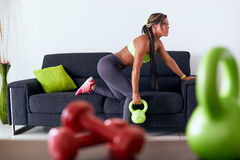 Home Fitness Black Woman Training With Weights On Sofa Stock Images