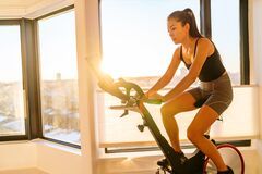 Free Home Fitness Workout Woman Training On Smart Stationary Bike Indoors Watching Screen Connected Online To Live Streaming Stock Image - 194677971