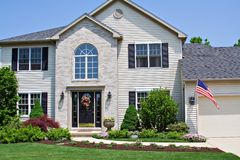 Home with Flag. A beautiful neat suburban home in Ohio flying the American Flag Stock Images