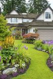 Home and Floral Garden. Beautiful home and garden with annuals and perennials in full bloom Royalty Free Stock Images