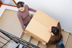 home flytta sig som är nytt till Arkivbild