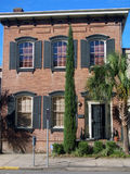 Home with Foliage Spire. A home in Savannah, Georgia with large foliage Stock Photos