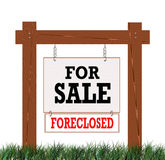 Home Foreclosed Sign. Wooden Real Estate For Sale Sign with a Foreclosed sign attached Stock Photography