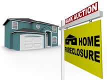Home Foreclosure Sign in Front of House. A home foreclosure sign stands in front of an attractive home Stock Photography