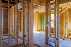 Home Framing unfinished wood frame building or a house stock photo