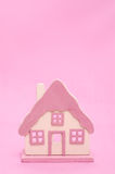 Home in front of a pink background with text space Stock Images