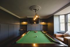 Home Games Room. Wide angle view of an interior of a games room in a house stock photography