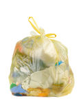 Home Garbage. Yellow parcel with garbage isolated over white Royalty Free Stock Photo