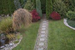 Home garden in the fall with vivid autumn colors. Stock Photos