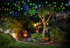 Home garden festive illumination lights. Home garden illumination autumn evening patio festive party lights royalty free stock photography