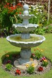 Home garden fountain. Summer time home garden fountain Stock Photos