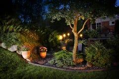 Home garden illumination lights. Home garden illumination autumn evening patio lights stock images
