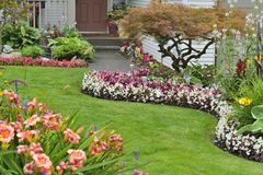 Home Garden. Landscaped home garden with a variety of annuals and perrenials in full bloom Stock Image