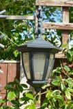 Home garden lantern. Summer time home garden lantern, light Stock Photography