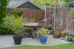 Home garden. Patio area, with table and chairs Royalty Free Stock Images