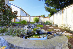 Home garden with small pond Stock Image