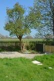 Home garden. Spring, summer home garden over looking a field Royalty Free Stock Photo