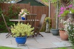 Home garden. Summer time home garden patio area Royalty Free Stock Photos