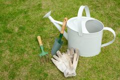 Home garden tools. Sat on a grass background Royalty Free Stock Images