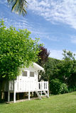 Home garden with a white hut Royalty Free Stock Photography