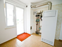 Home gas furnace. A view of a gas furnace or central heating system in a private home