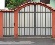 Home gate. Arch gate and door home fence Royalty Free Stock Photography