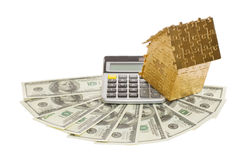 Home of gold color on a calculator and dollars. Isolated on white background Stock Photography