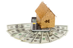 Home of gold color on a calculator and dollars Stock Photos