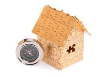 Home of gold color puzzles with a keys. Stock Images