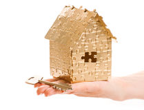 Home of gold color puzzles with a keys. Royalty Free Stock Photos