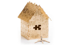 Home of gold color puzzles with a keys. Royalty Free Stock Images