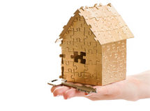 Home of gold color puzzles with a keys. Royalty Free Stock Photo