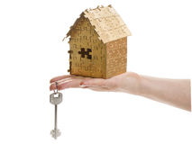 Home of gold color puzzles with a keys. Royalty Free Stock Photography