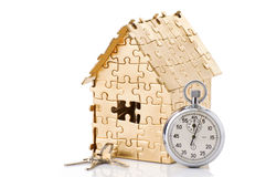 Home of gold color puzzles with a stopwatch Stock Photography
