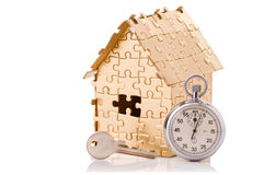 Home of gold color puzzles with a stopwatch Royalty Free Stock Photos