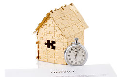 Home of gold color puzzles with a stopwatch Stock Photo