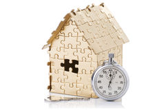 Home of gold color puzzles with a stopwatch Stock Images